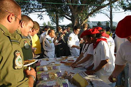 230 Squadron aircrew in-line to have a taste of Frances finest food served by the Mont-De-Marsan team during the Beja Tiger Meet International evening
